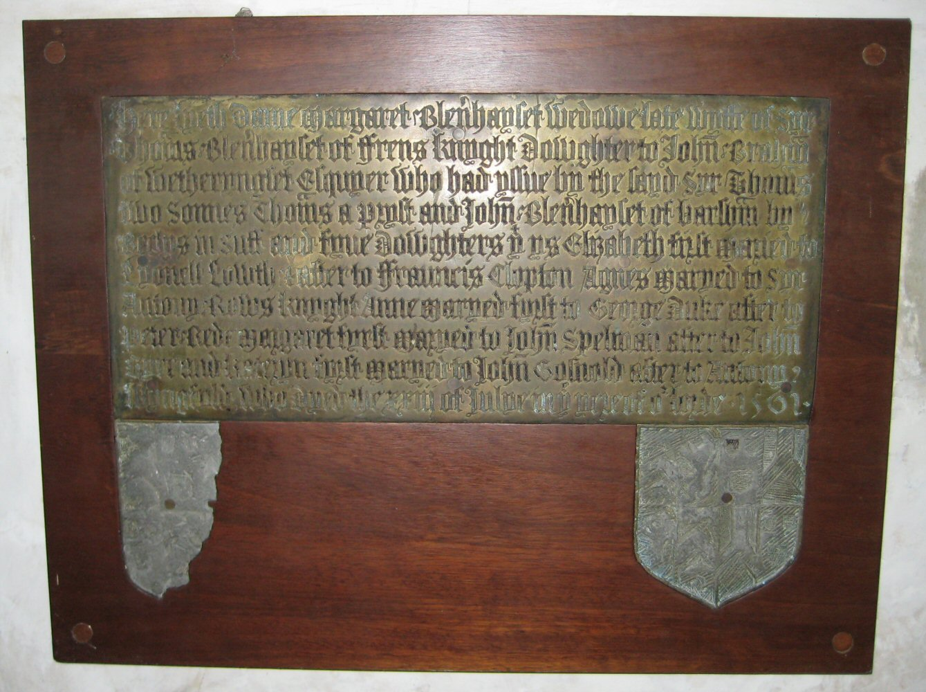 Inscription brass for Dame Margaret BH 1561, above two surviving shields of arms for her husband Sir Thomas BH 1531